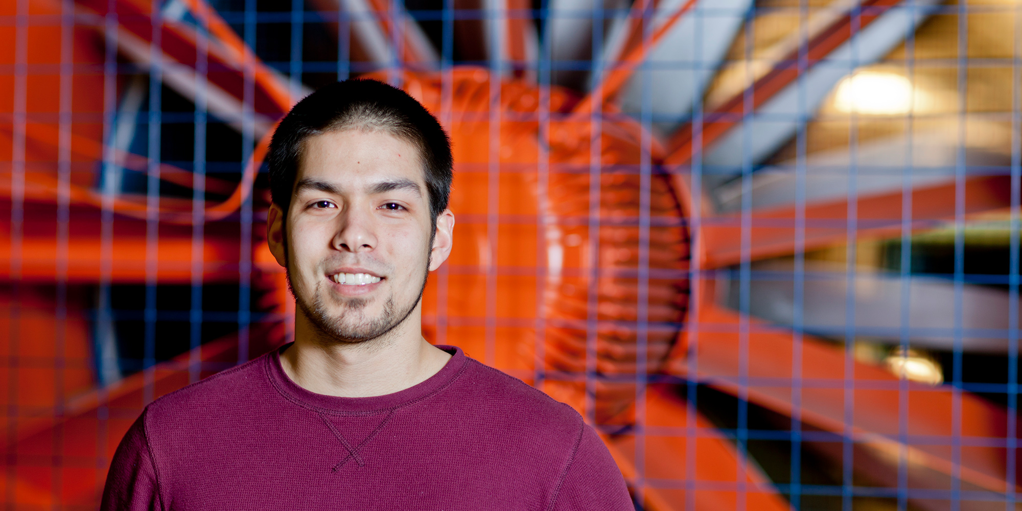 Student in front of the wind tunnel