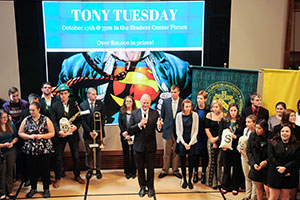 Students and President Tony Collins on stage during Tony Tuesday