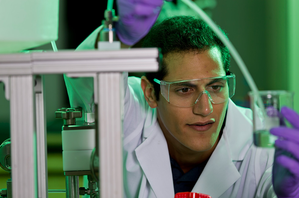 Chemical engineering major, Andrew Akiki working on an experiment