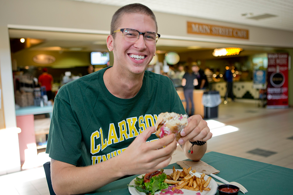 Student eating food at Cheel arena
