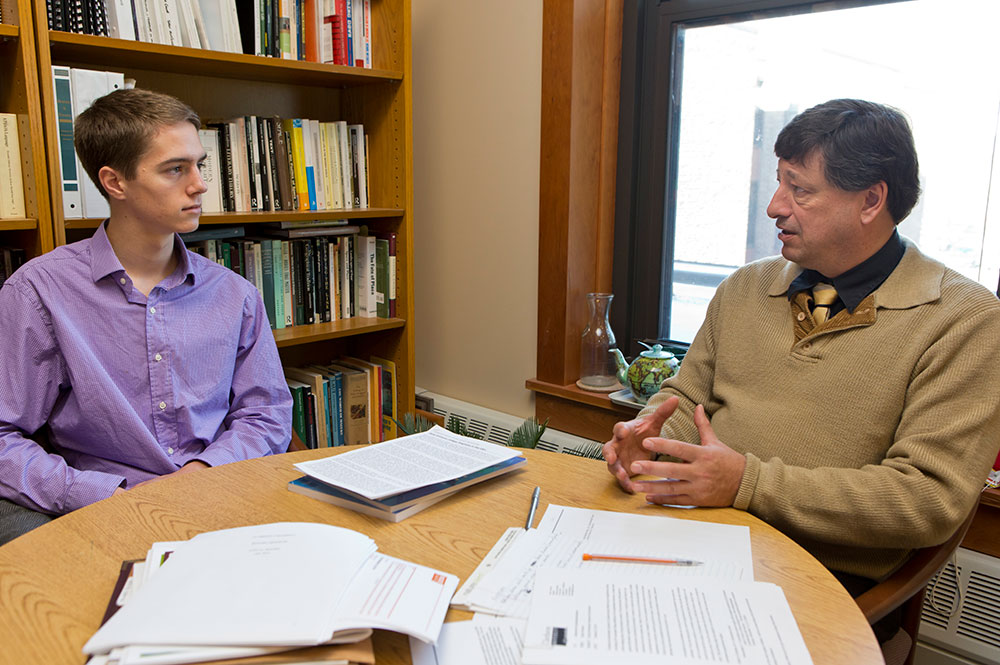 Jon Goss, director of Clarkson's Honors Program, advises an undergraduate Honors student