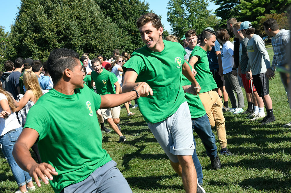 Clarkson students participate in a first-year orientation activity on Cheel Lawn