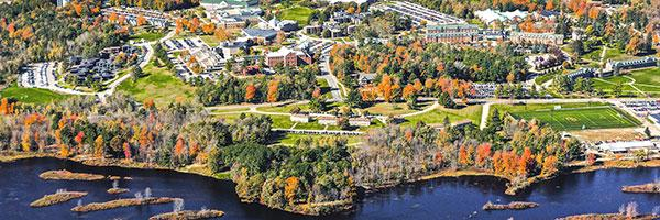 A drone aerial photo of Clarkson University's Main Campus in Potsdam, New York showcases the natural beauty of the campus in fall.