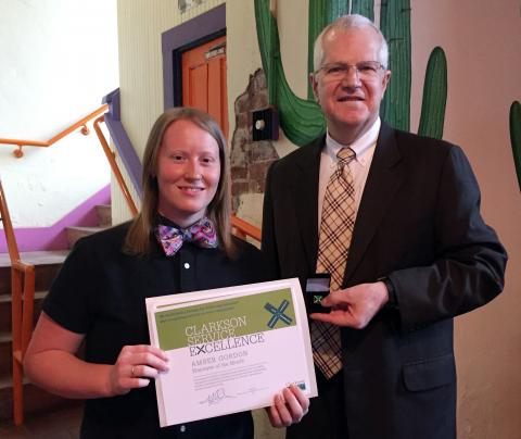 Clarkson University OIT Team Lead Amber Gordon, left, receives the Employee of the Month certificate and pin from Senior Vice President and Provost Chuck Thorpe.