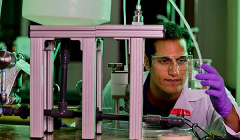 A School of Engineering student works in a lab. Clarkson is a great school for chemical engineering and chemical engineers.