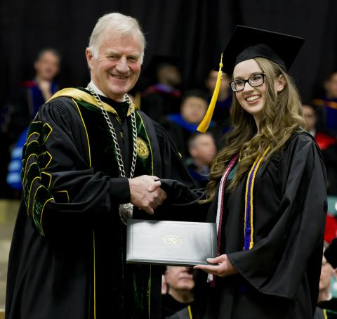 Clarkson University President Tony Collins (left) presents the Levinus Clarkson Award to Leah Granger.
