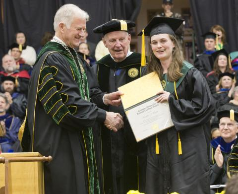 Clarkson University President Tony Collins (left) and University Trustee Dr. Bayard D. Clarkson Sr. present the Levinus Clarkson Award to Kaitlin Dunn.