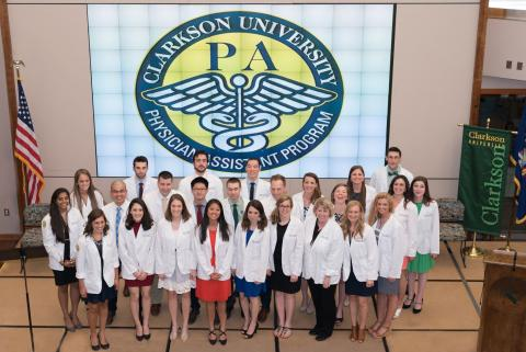 The Clarkson University Department of Physician Assistant (PA) Studies will hold an open house on Wednesday, October 5, from 4 to 6 p.m. in celebration of PA Week. Above, the Clarkson Master of Science in Physician Assistant Studies Class of 2018 at the program's White Coat Ceremony, which marks the first-year student's transition from classroom studies to clinical studies.