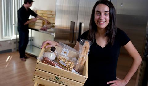 Kristen Cardella with a box of food from Golden Grown