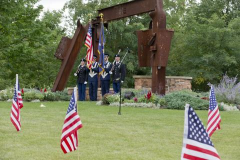The Clarkson University Air Force and Army ROTC color guard at the 2016 9/11 remembrance ceremony in front of Clarkson's World Trade Center Memorial Sculpture.