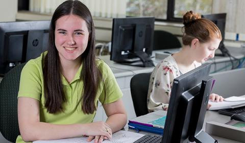 TCS Student, Amanda Horne in a computer classroom with another student