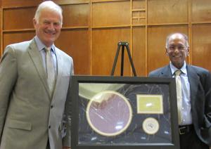 Clarkson University President Tony Collins (left) congratulates Distinguished University Professor of Chemical and Biomolecular Engineering S.V. Babu, former director of Clarkson's Center for Advanced Materials Processing (CAMP), on his recognition by the Intel Portland Technology Development CMP staff.