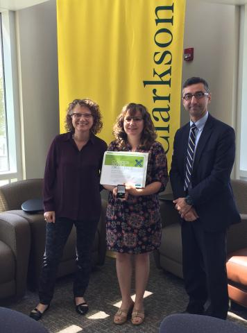 Clarkson University Department of Education Coordinator Nicki Foley has been named the Employee of the Month for August. Above, Foley (center) receives her Employee of the Month certificate and pin from Department of Education Chair Catherine Snyder (left) and Graduate School Dean Kerop Janoyan.