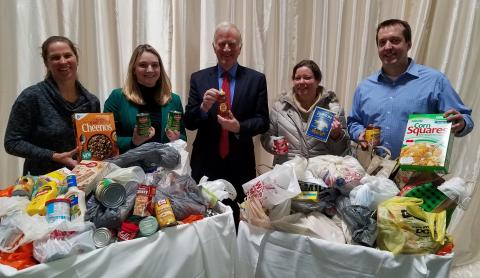 Clarkson staff pose with holiday food donations