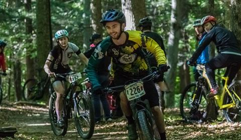 A Clarkson mountain bike club student competes at a race on Clarkson's campus