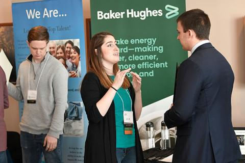 A Clarkson undergraduate environmental engineering student talks to a representative of potential employer Baker Hughes