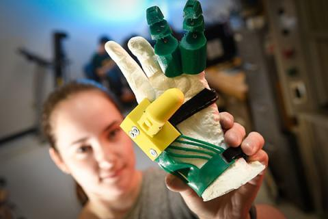 A Mechanical Engineering undergraduate student performs research in Professor Kevin Fite lab with a prosthetic hand