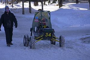 The Clarkson Baja SAE engineering project team competes in a competition in the snow.