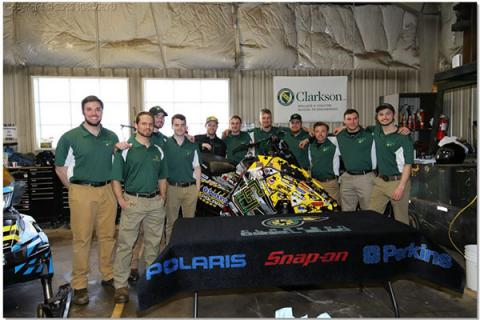 Clarkson's SAE Clean Snowmobile Diesel Sled Team members pose for a photo with their winning snowmobile