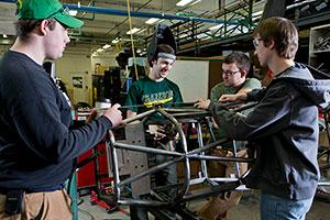 Members of Clarkson's Formula SAE SPEED team work on parts and components for their race car in the SPEED lab