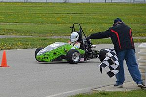 A member of Clarkson's Formula SAE Knights racing SPEED team races in a competition