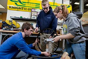 Students from Clarkson's Human Powered Vehicle SPEED team work on their engineering design project