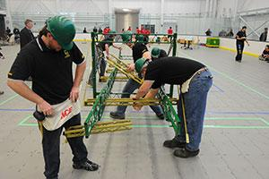 Students from Clarkson's Steel Bridge SPEED team build their steel bridge during a competition