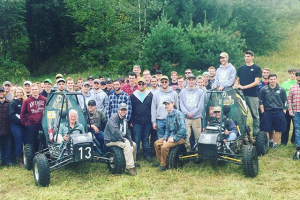 Clarkson's Baja SAE SPEED team poses with President Tony Collins