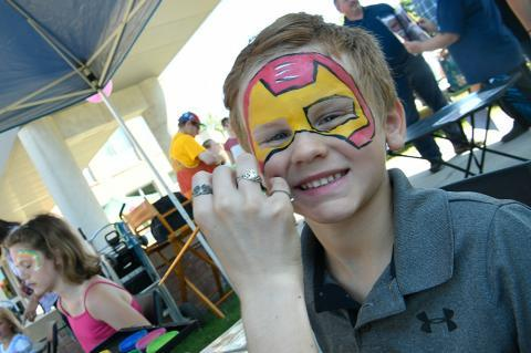 Employee picnic, face painting for kids