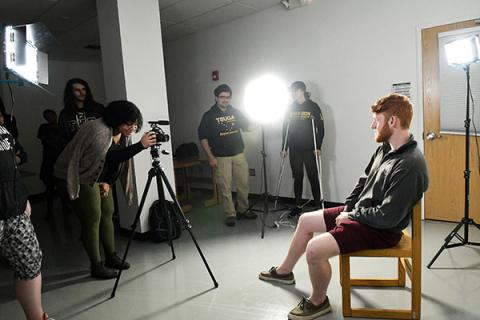 Undergraduate students in one of Clarkson's communication, media and design programs set up to practice film production.