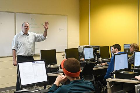 Clarkson Mathematics Professor Joe Skufca teaches a class of undergraduate students in a computer lab