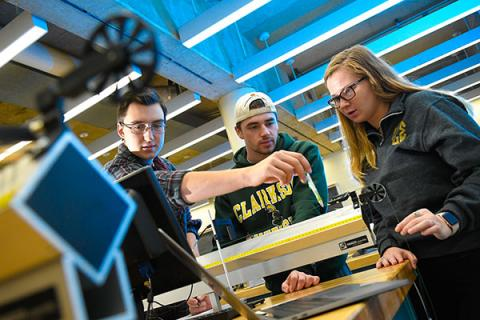 Clarkson undergraduate students conduct physics research in a lab on campus