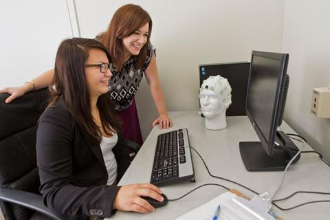 Clarkson Psychology Professor Lisa Legault and an undergraduate student work together on a research project on a computer