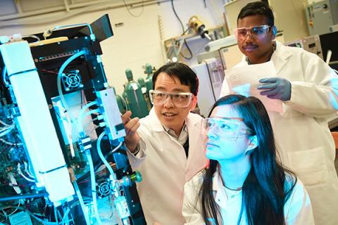 Clarkson chemical engineering faculty and graduate students work on research in a lab