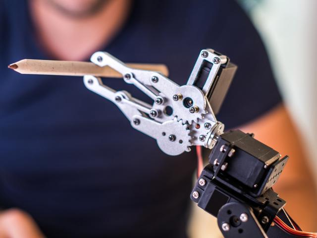 Individual working on a robotic hand