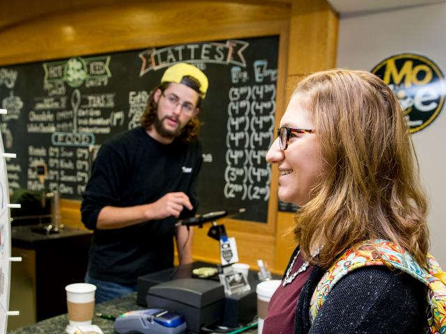 Student at MoJoe coffee a student run business