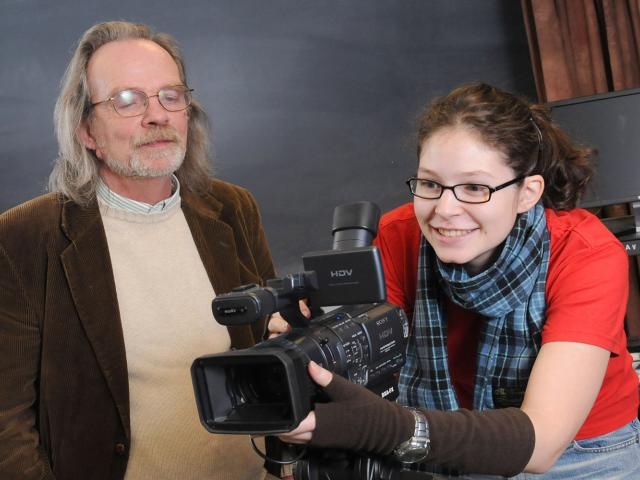 Professor Dan Dullea and a student learning how to capture the moment on a video camera