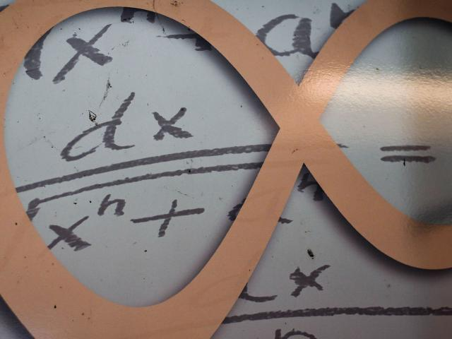 Infinity symbol with Math, finance, accounting