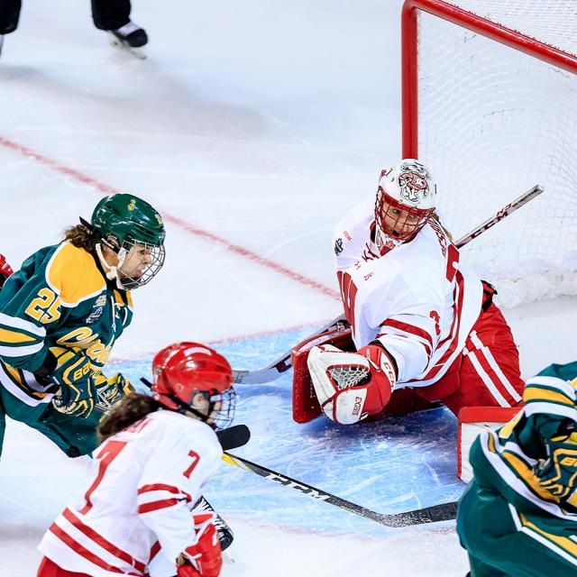 Clarkson Women's Hockey player, Cayley Mercer scoring a goal on Wisconsin during the 2017 Frozen Four Hockey Championships