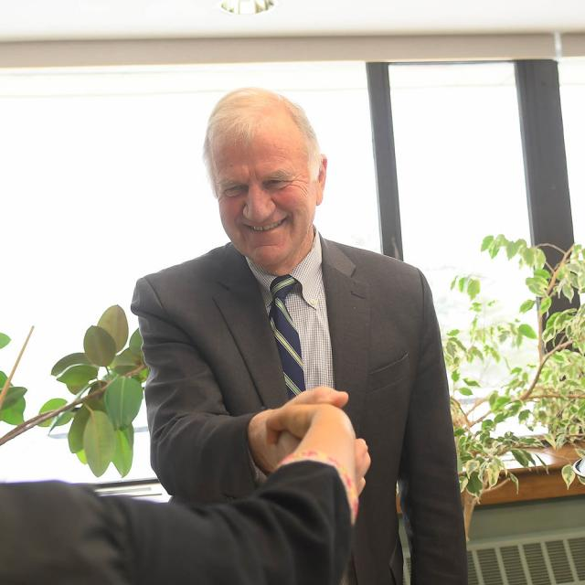 President Tony Collins Shaking someones hand